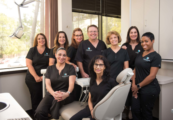 Dr. Ron Hickerson with his staff at Hickerson & Associates, DDS. PC. in Houston, TX.